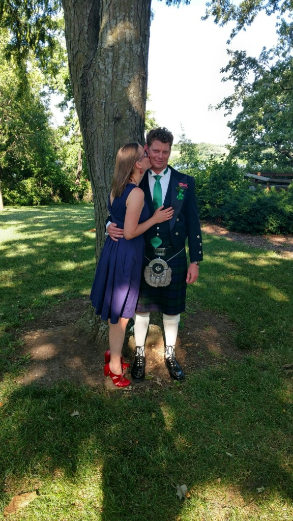 The Viking and I at a wedding. He's wearing a kilt. It's pretty awesome.