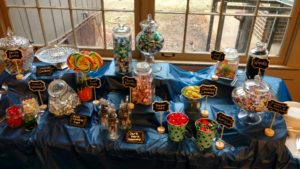 Table with jars of candy labeled with Harry Potter names